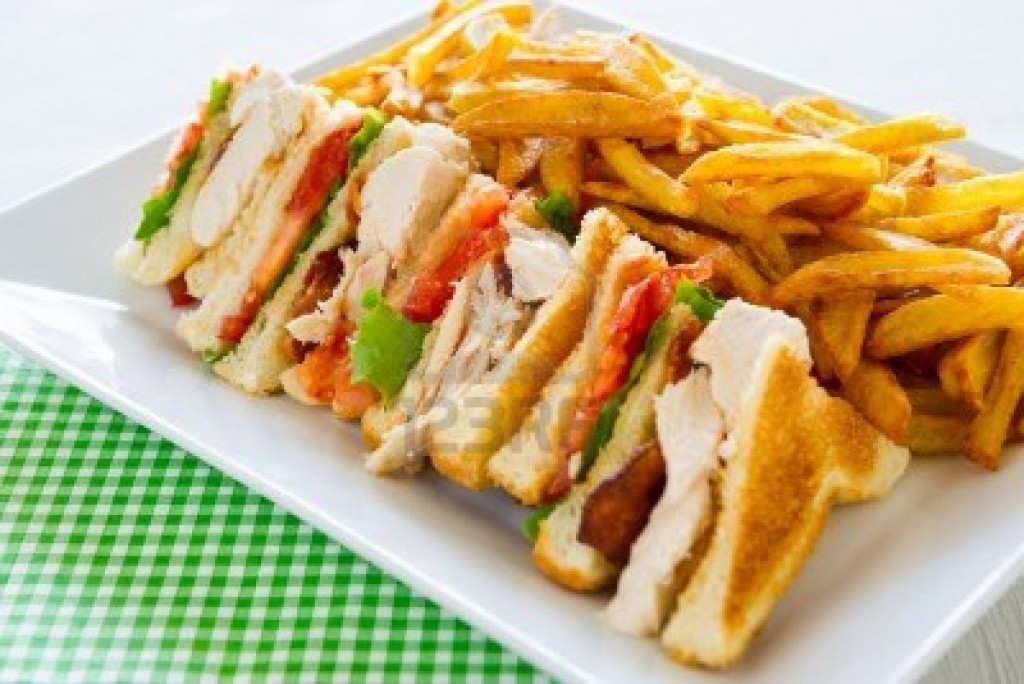 Chicken club sandwich in a white plate meal time